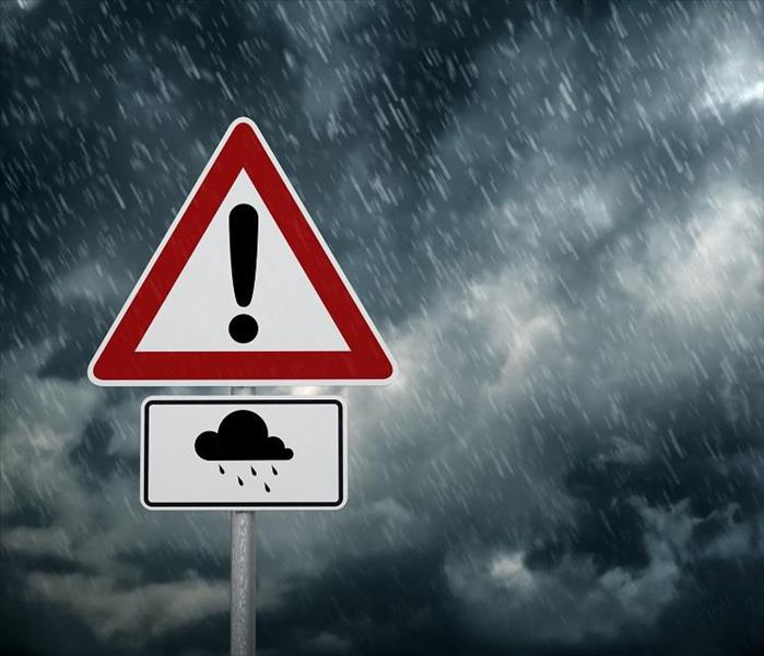 Storm hazard sign.  Background is black storm clouds
